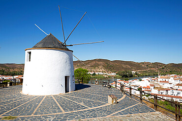 Windmill above village and Rio Guadiana river with view to Portugal, Sanlucar de Guadiana, Huelva Province, Andalucia, Spain, Europe