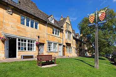 Town sign and Cotswold stone cottages along High Street, Chipping Campden, Cotswolds, Gloucestershire, England, United Kingdom, Europe