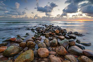 Rock breakwater in sea at sunrise, Munkerup, Kattegat Coast, Zealand, Denmark, Scandinavia, Europe