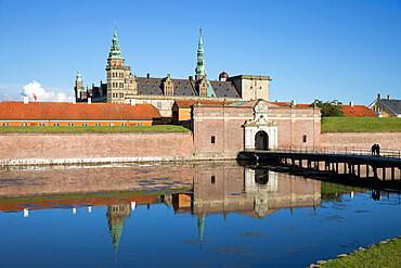 View over moat to entrance gate of Kronborg Castle used as setting for Shakespeare's Hamlet, Helsingor, Zealand, Denmark, Scandinavia, Europe