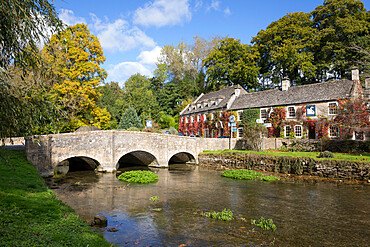 River Coln and The Swan Hotel in autumn, Bibury, Cotswolds, Gloucestershire, England, United Kingdom, Europe