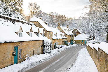 Line of Cotswold stone cottages covered in winter snow, Snowshill, Cotswolds, Gloucestershire, England, United Kingdom, Europe