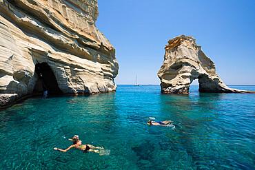 Snorkellers amongst rock formations with crystal clear water, Kleftiko, Milos, Cyclades, Aegean Sea, Greek Islands, Greece, Europe