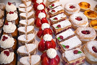 Tasty pastries in window of French patisserie shop, Arras, Pas-de-Calais, Hauts-de-France region, France, Europe