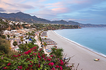 Sunset view over Nerja Playa Burriana beach, Nerja, Malaga Province, Costa del Sol, Andalucia, Spain, Europe