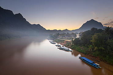 Sunset over the misty Nam Ou River at the village of Nong Khiaw, Luang Prabang Province, Northern Laos, Laos, Indochina, Southeast Asia, Asia