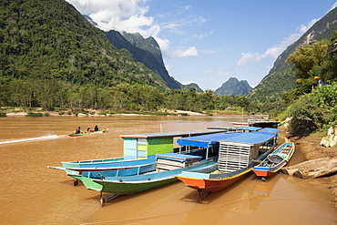Boats docked on the Nam Ou River at Muang Ngoi Neua looking north, Luang Prabang Province, Northern Laos, Laos, Indochina, Southeast Asia, Asia