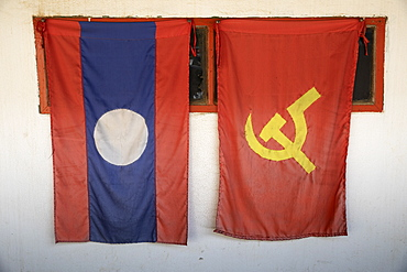 Laos National and Lao People's Revolutionary Party (LPRP) flags, Nong Khiaw, Northern Laos, Laos, Indochina, Southeast Asia, Asia