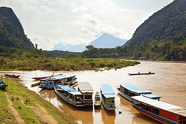 Boats on the Nam Ou River at Muang Ngoi Neua, Muang Ngoi District, Luang Prabang Province, Northern Laos, Laos, Indochina, Southeast Asia, Asia