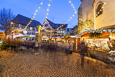 Christmas market at the Place du Marche aux Saules, Eguisheim, Alsace, France, Europe
