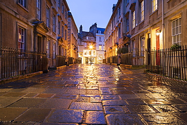 Wet paving stones and Georgian houses along the North Parade buildings, Bath, UNESCO World Heritage Site, Somerset, England, United Kingdom, Europe