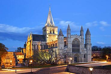The west front of the Norman built Rochester Cathedral floodlit at night, Rochester, Kent, England, United Kingdom, Europe