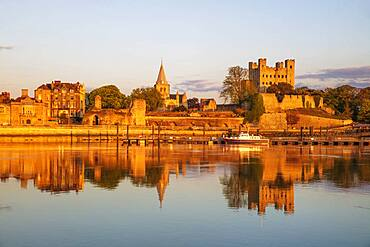 View across the River Medway to Rochester Castle and Cathedral at sunset, Rochester, Kent, England, United Kingdom, Europe