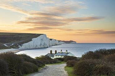 Seven Sisters and Beachy Head with coastguard cottages at sunrise in spring, Seaford Head, East Sussex, England, United Kingdom, Europe