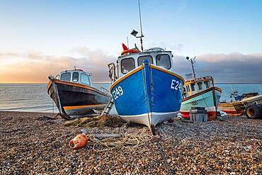 Fishing boats pulled up on shingle beach at sunrise, Beer, Jurassic Coast, Devon, England, United Kingdom, Europe