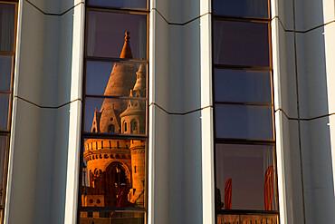 Fishermen's Bastion (Halaszbastya) reflected in windows of Hilton Hotel, Buda, Budapest, Hungary, Europe
