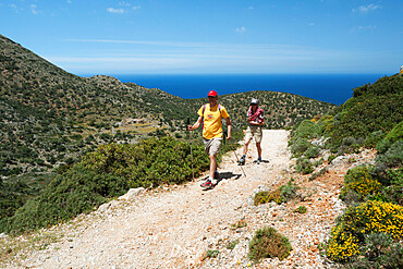 Walkers on coastal walk, Akrotiri Peninsula, Chania region, Crete, Greek Islands, Greece, Europe