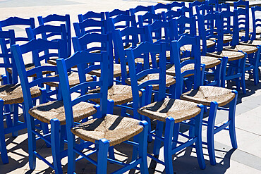 Blue Greek restaurant chairs, Crete, Greek Islands, Greece, Europe