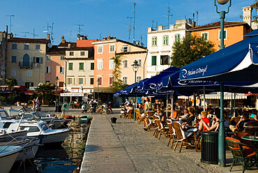 Cafe scene along the harbour, Rovinj, Istria, Croatia, Adriatic, Europe