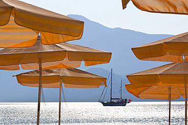 Umbrellas and yacht, Psili Ammos, Samos, Aegean Islands, Greece