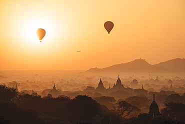 View of temples and hot air balloons at dawn, Bagan (Pagan), Mandalay Region, Myanmar (Burma), Asia