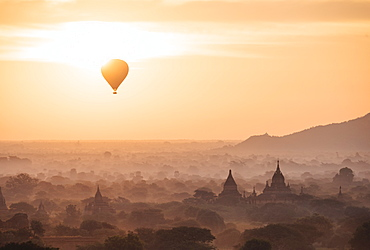 View of hot air balloon and temples at dawn, Bagan (Pagan), Mandalay Region, Myanmar (Burma), Asia