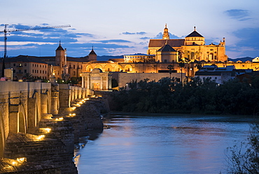 The Cathedral and Great Mosque of Cordoba (Mezquita) and Roman Bridge at twilight, UNESCO World Heritage Site, Cordoba, Andalucia, Spain, Europe