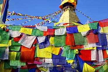 Prayer flags in front of Boudha (Bodhnath) (Boudhanath) Tibetan stupa in Kathmandu, UNESCO World Heritage Site, Nepal, Asia