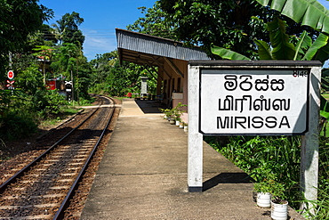 Platform sign and tracks at Mirissa train station in the south of Sri Lanka, Asia
