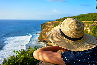 Looking out at limestone cliffs and the Indian Ocean viewed from Uluwatu Temple, Pecatu, Bali, Indonesia, Southeast Asia, Asia