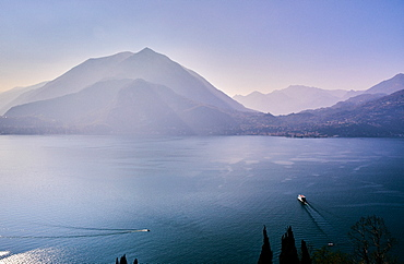 High angle view of Lake Como with a ferry boat travelling across the lake, Lombardy, Italian Lakes, Italy, Europe