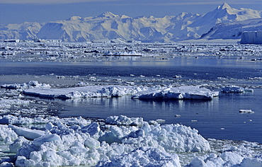 Open pack ice and Admiralty Mountains Range in background. Adare Peninsula, Ross Sea, Antarctica