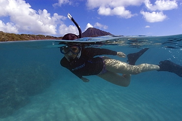 Split image of snorkeller hovering over sandy substrate, Hanauma Bay, Oahu, Hawaii, United States of America, Pacific