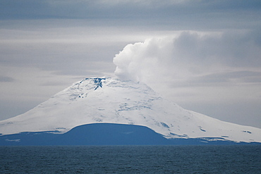 Saunders Island with steam rising from the lava lake, South Sandwich Islands, Polar Regions