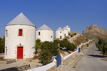 Row of old windmills on Pitiki Hill below Panteli castle, Platanos, Leros, Dodecanese Islands, Greek Islands, Greece, Europe