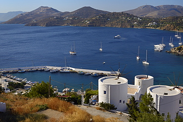 Old windmills, restored as holiday accommodation above Panteli harbour, Leros, Dodecanese Islands, Greek Islands, Greece, Europe