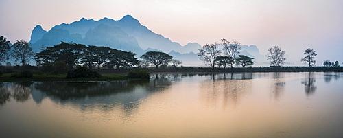 Misty morning at Kyauk Kalap Buddhist Temple at sunrise, Hpa An, Kayin State, Myanmar (Burma), Asia
