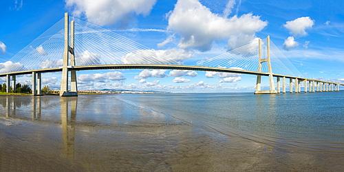 Vasco de Gama Bridge reflecting in the Tagus River, Lisbon, Portugal, Europe