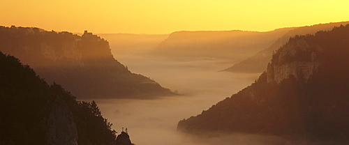 View from Eichfelsen Rock on Schloss Werenwag Castle and Danube Valley at sunrise, Upper Danube Nature Park, Swabian Alb, Baden Wurttemberg, Germany, Europe