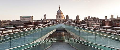 Millennium Bridge and St. Paul's Cathedral at sunrise, London, England, United Kingdom, Europe