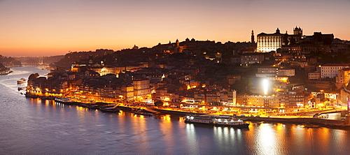 View over Douro River at sunset to Ribeira District, UNESCO World Heritage Site, Porto (Oporto), Portugal, Europe