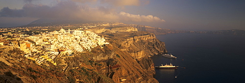Panoramic image of Fira in the evening with cruiser and volcanic landscape, Santorini, Cyclades, Greek Islands, Greece, Europe