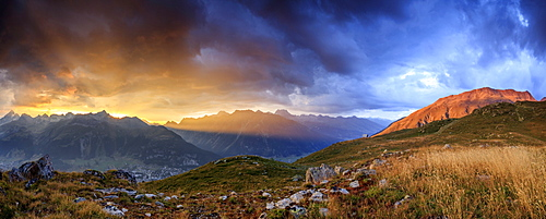 Panorama of the fiery sky on high peaks of Muottas Muragl at sunset, St. Moritz,  Canton of Graubunden, Engadine, Switzerland, Europe