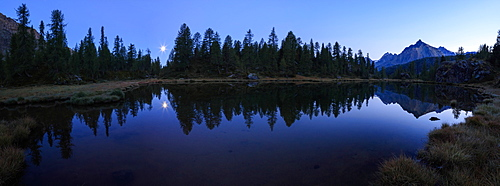 Panorama of the blue Lake Mufule lit by the moon, Malenco Valley, Province of Sondrio, Valtellina, Lombardy, Italy, Europe