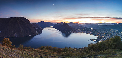 Panoramic of Lake Lugano at sunset from Monte Bre, Canton of Ticino, Switzerland, Europe
