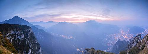 Panoramic view of Lecco, Monte Resegone and Grigna from Monte Coltignone at dawn, Valsassina, Lombardy, Italian Alps, Italy, Europe