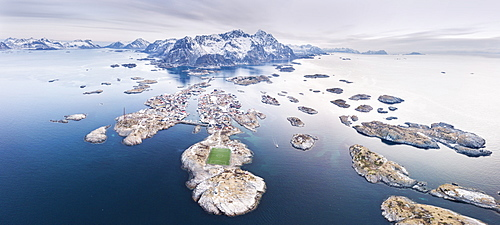 Panoramic aerial view of soccer pitch and islets, Henningsvaer, Vagan municipality, Lofoten Islands, Nordland, Norway, Europe