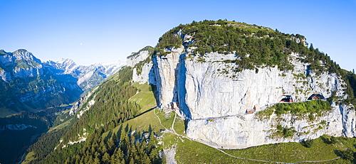 Aerial panoramic of Wildkirchli (Wild Chapel) and caves on rock face, Ebenalp, Appenzell Innerrhoden, Switzerland, Europe