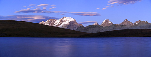 Panorama of the Gran Paradiso range at sunset from Lake Rossett, Colle del Nivolet, Alpi Graie (Graian Alps), Italy, Europe