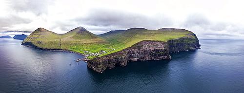 Panoramic aerial view of cliffs and village of Gjogv, Eysturoy island, Faroe Islands, Denmark, Europe